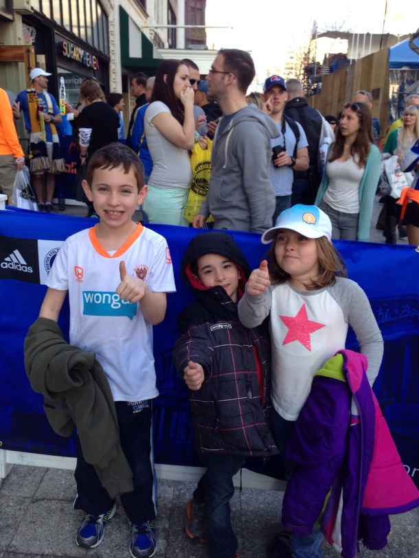 Kids at the Marathon Sports location near the finish line.  The site of one of the 2013 explosions.